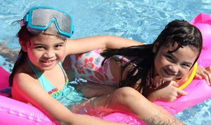 two-young-girls-enjoy-at-infiniity-resort-pool